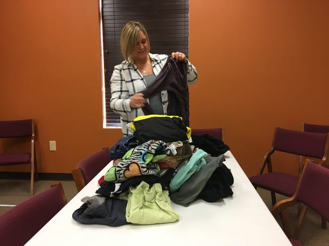 Jessie Smith folds and sorts donated clothes at New Life Presbyterian Church in Yorktown. The clothes are part of the Delaware County Foster Closet, which offers various necessities to foster families.
