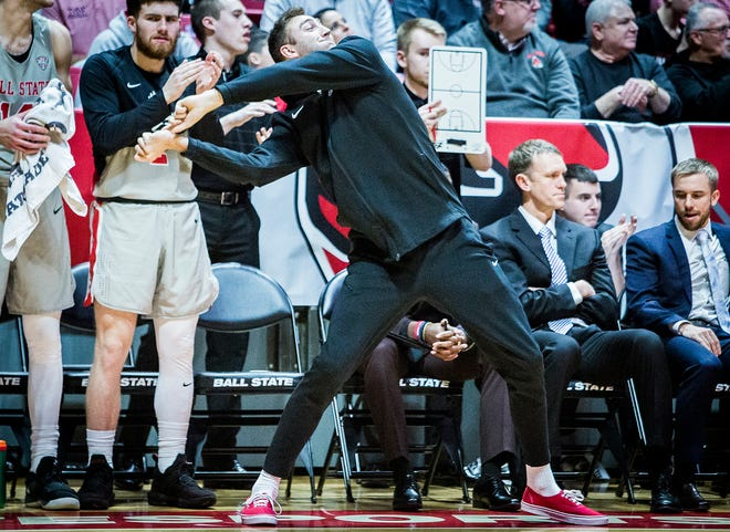 Ball State's Brachen Hazen cheers on his team during their game at Worthen Arena Thursday, Dec. 20, 2018.