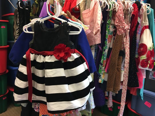 Donated dresses hang inside the Delaware County Foster Closet, housed at New Life Presbyterian Church in Yorktown.
