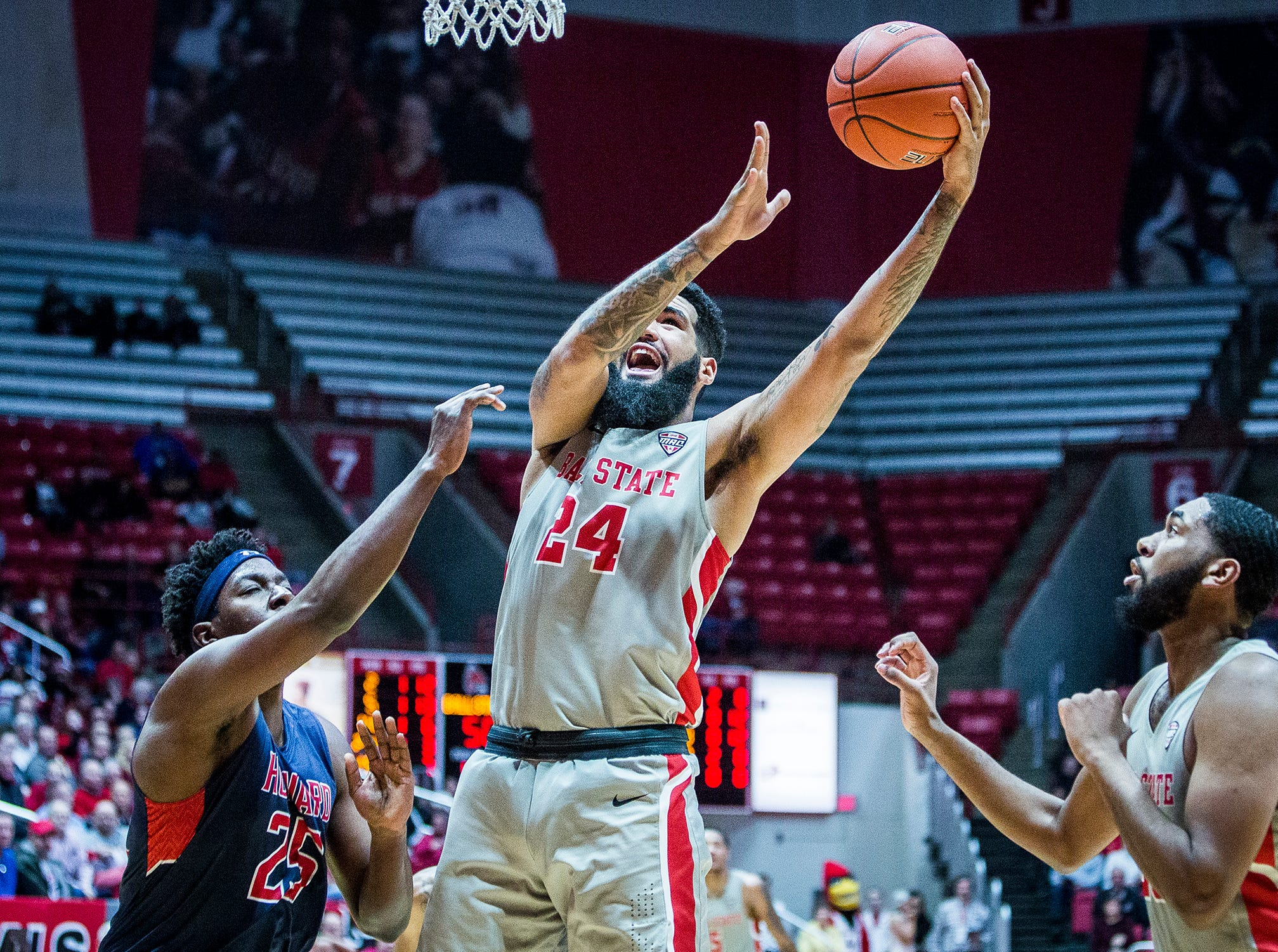 Ball State's Trey Moses shoots past Howard's defense during their game at Worthen Arena Thursday, Dec. 20, 2018.