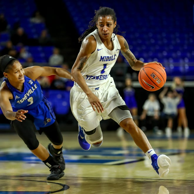 MTSU guard A'Queen Hayes drives past an opponent during the Lady Raiders' 67-44 win over UNC Asheville on Dec. 20, 2018. Hayes scored a career-high 31 points against the Bulldogs.
