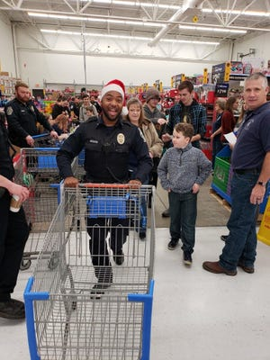 Officers and kids are excited to participate in this year's Cops and Kids event at the Walmart in Smyrna, Tenn.