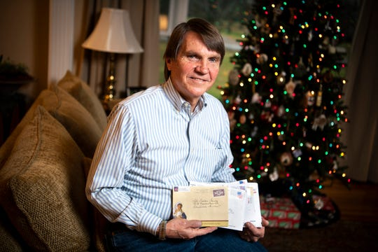 Mike Bouldin holds letters that he received in response to cards written by his brother Gary, who died in May, at his home in Brentwood. Gary had sent thousands of cards to friends, family and acquaintances in Grundy County over the years and after Gary's death, Mike discovered hundreds of cards already signed and partially ready to mail. He and his family mailed them out before Thanksgiving.