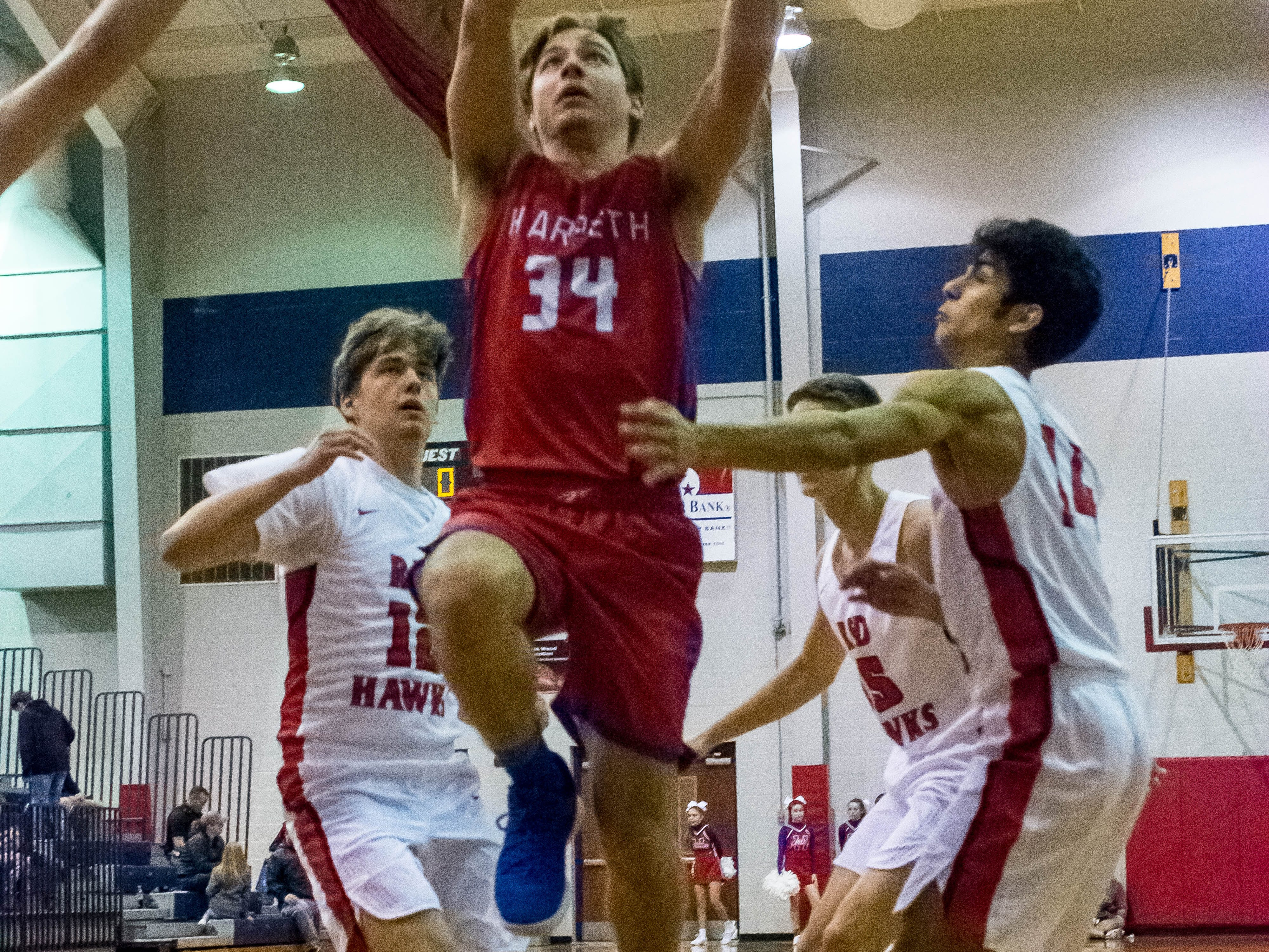 Harpeth's Luke Liles going up for two early in the 1st period