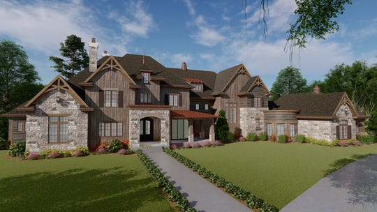 This rendering shows a custom home designed by architect Guy Land that is about to be built in Franklin. This rustic French country style home has natural wood siding and native stone.