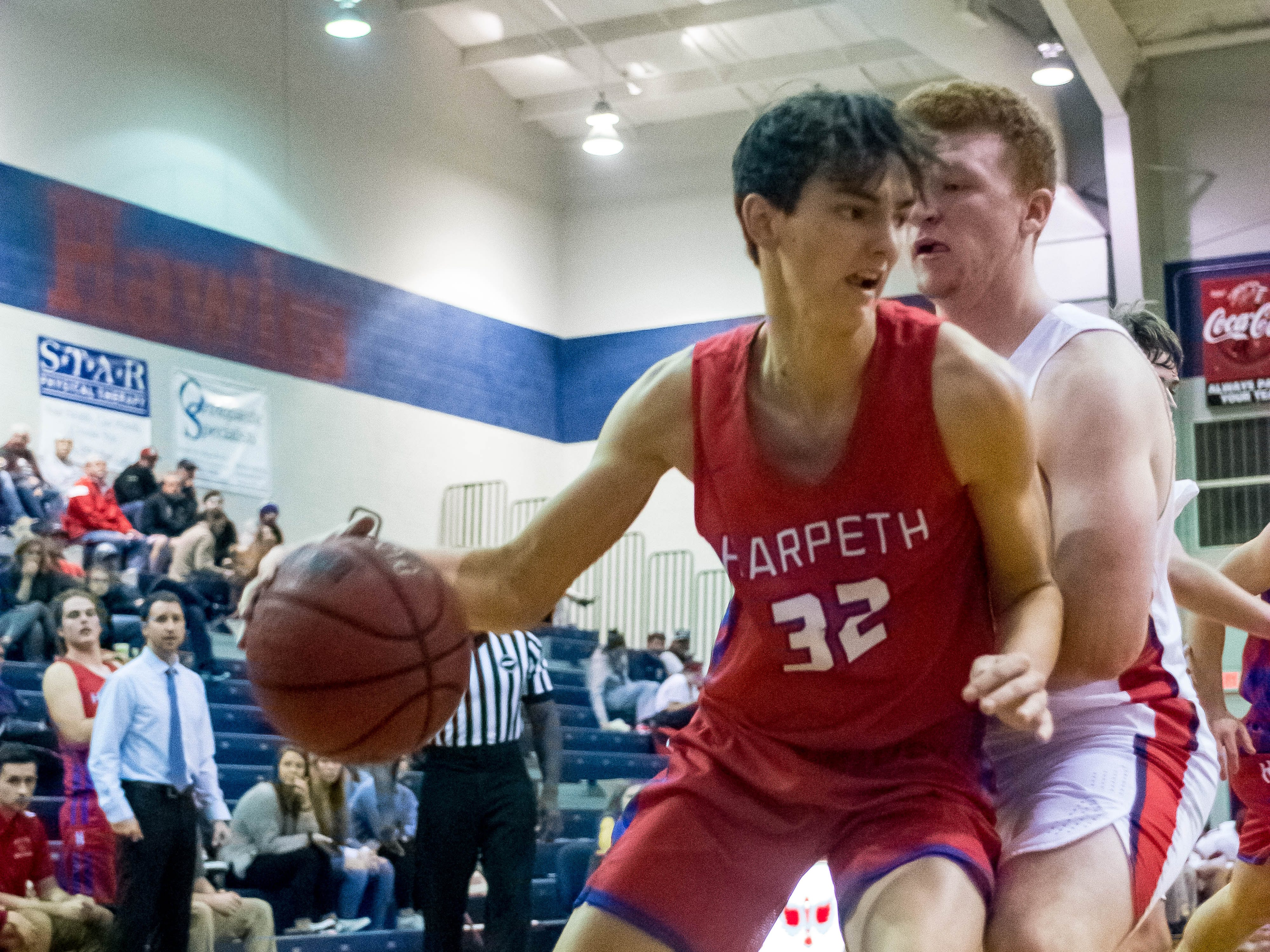Harpeth Sophomre Will Collier driving to the basket.