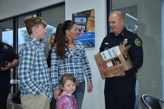 Gallatin Police Chief Don Bandy gives the Davis family, who lost everything in a house fire, a Wii for Christmas.