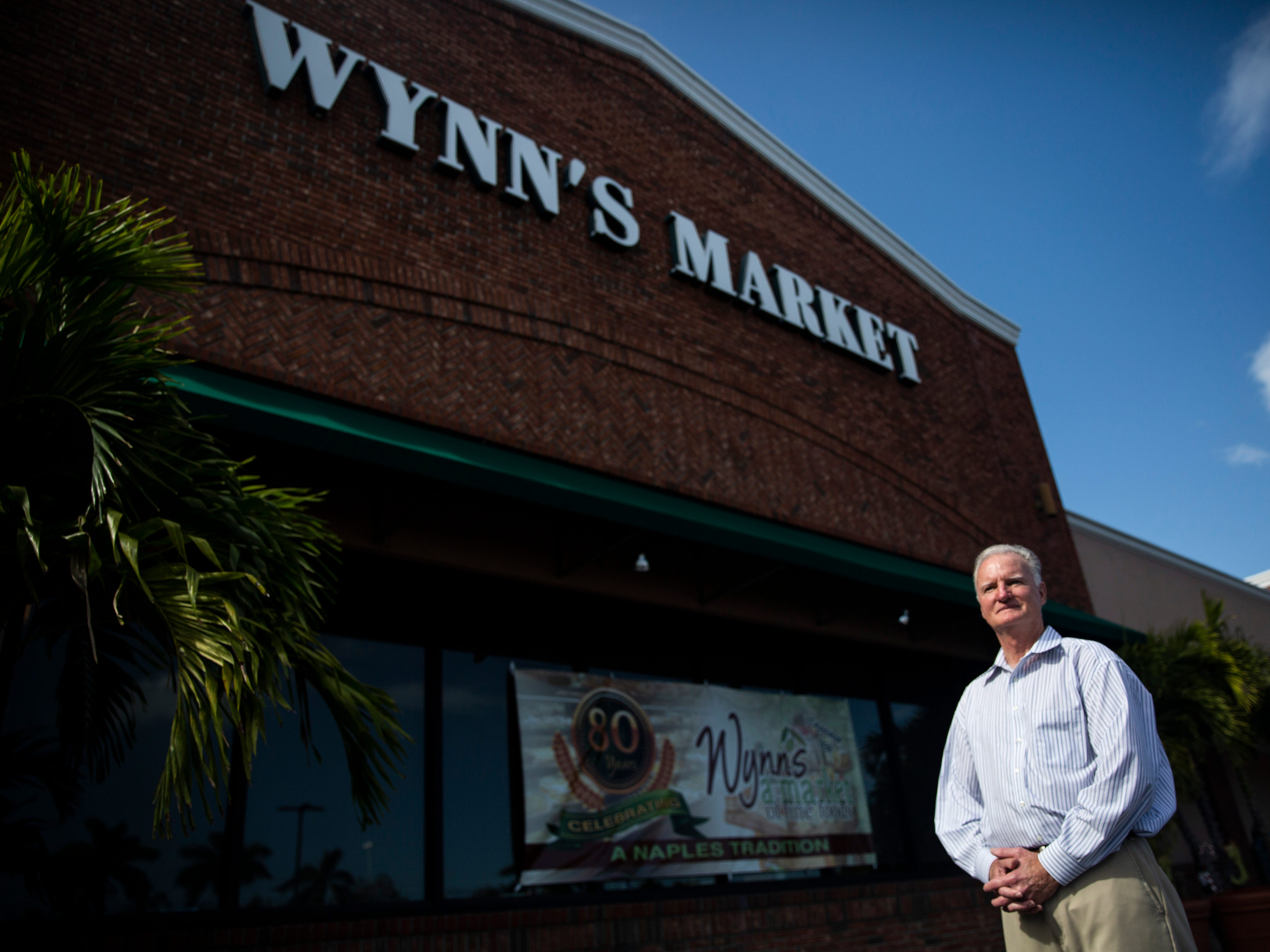 Tim Wynn stands outside Wynn's Market, which is celebrating its 80th anniversary this year, on Friday, Dec. 21, 2018, in Naples.