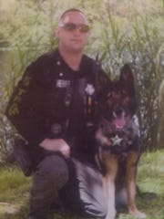 Nathan Kirk with his K-9, Rocky.