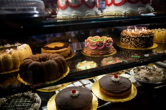 Cakes and other desserts fill a display case in the bakery on Friday, Dec. 21, 2018, at Wynn's Market in Naples. Wynn's Market is celebrating 80 years in business this year.