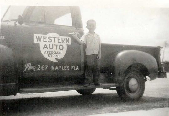 Larry Wynn stands on the running board of a Western Auto Delivery truck before the business was converted into Sunshine Hardware in 1958.