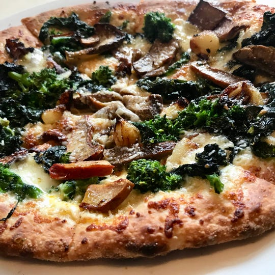 The Verdura Mista wood-fired pizza at Campiello in Naples includes broccoli rabe, Tuscan kale, cipollini onions, seasonal mushrooms and Taleggio cheese.