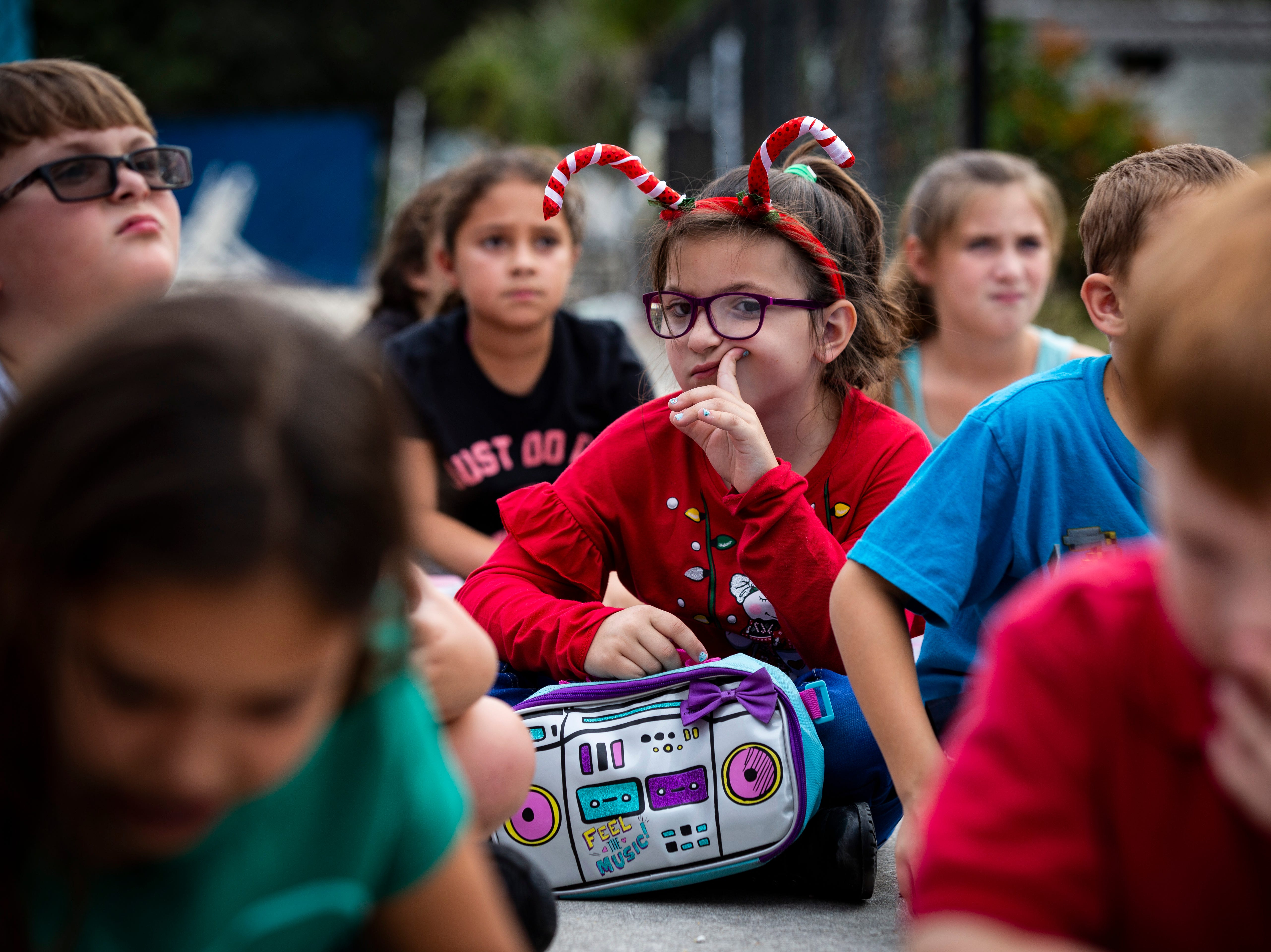 Josie Robinson, 7, waits to go walk on the nature trail during the YMCA after school program at Bonita Springs on Wednesday afternoon, Dec. 19, 2018.