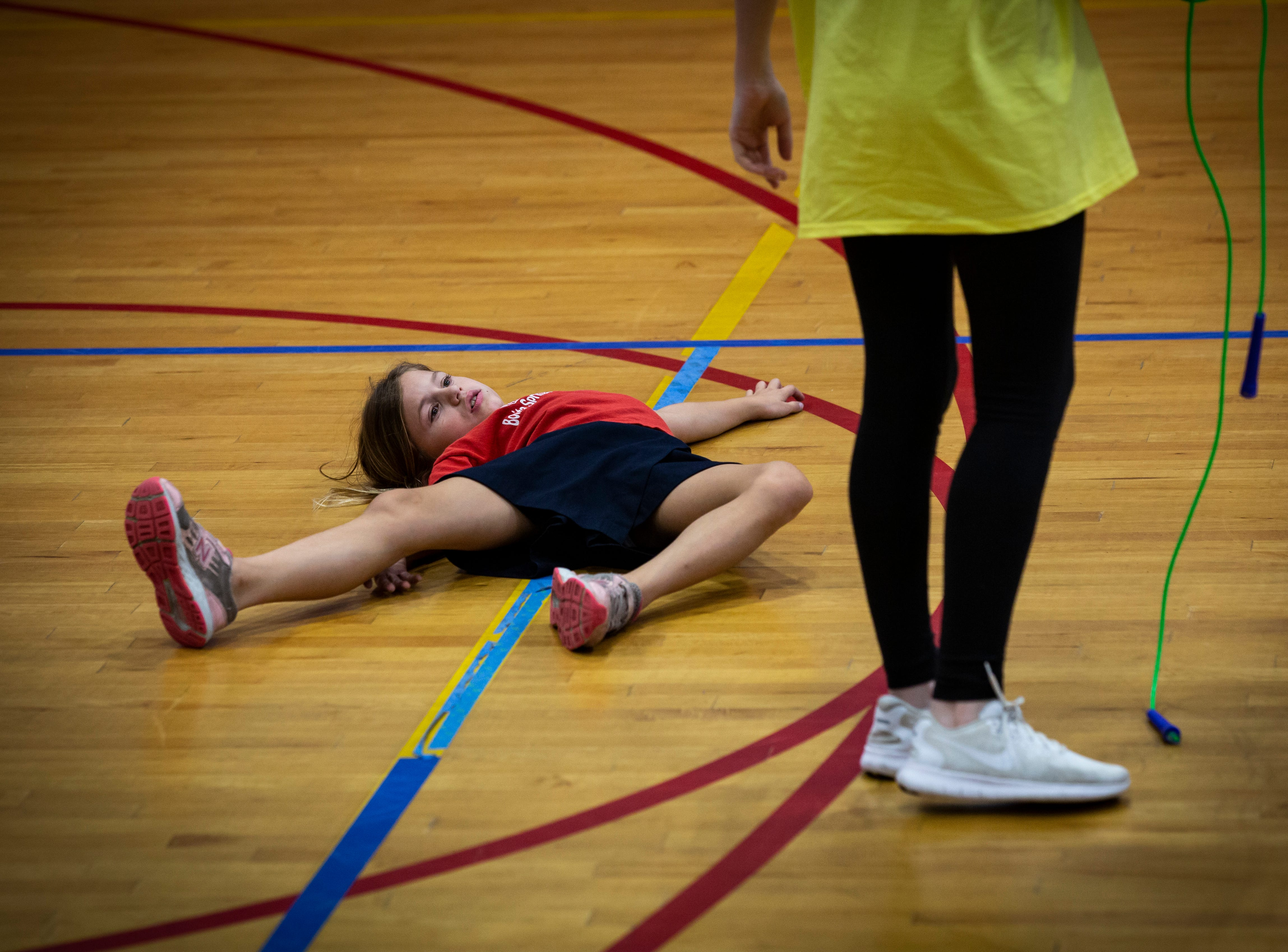 Alison Krape, 8, throws a tantrum to her counselor, Brooke Horgan during the YMCA after school program, Wednesday afternoon, Dec. 19, 2018, in Bonita Springs.