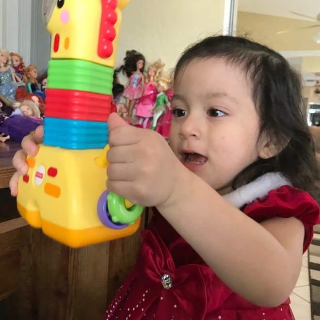 Isabella Soto, 2, of Naples, photographed in December 2018, has spent a year recovering after ingesting a button battery.