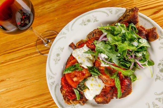 "Veal Rib Chop ""Parmigiana"" is on the new seasonal menu at Osteria Tulia on Fifth Avenue South in downtown Naples."