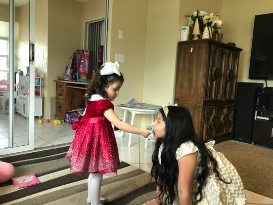 Isabella Soto, 2, left, plays with her older sister Danara Soto, 7, at their Naples home in December 2018.