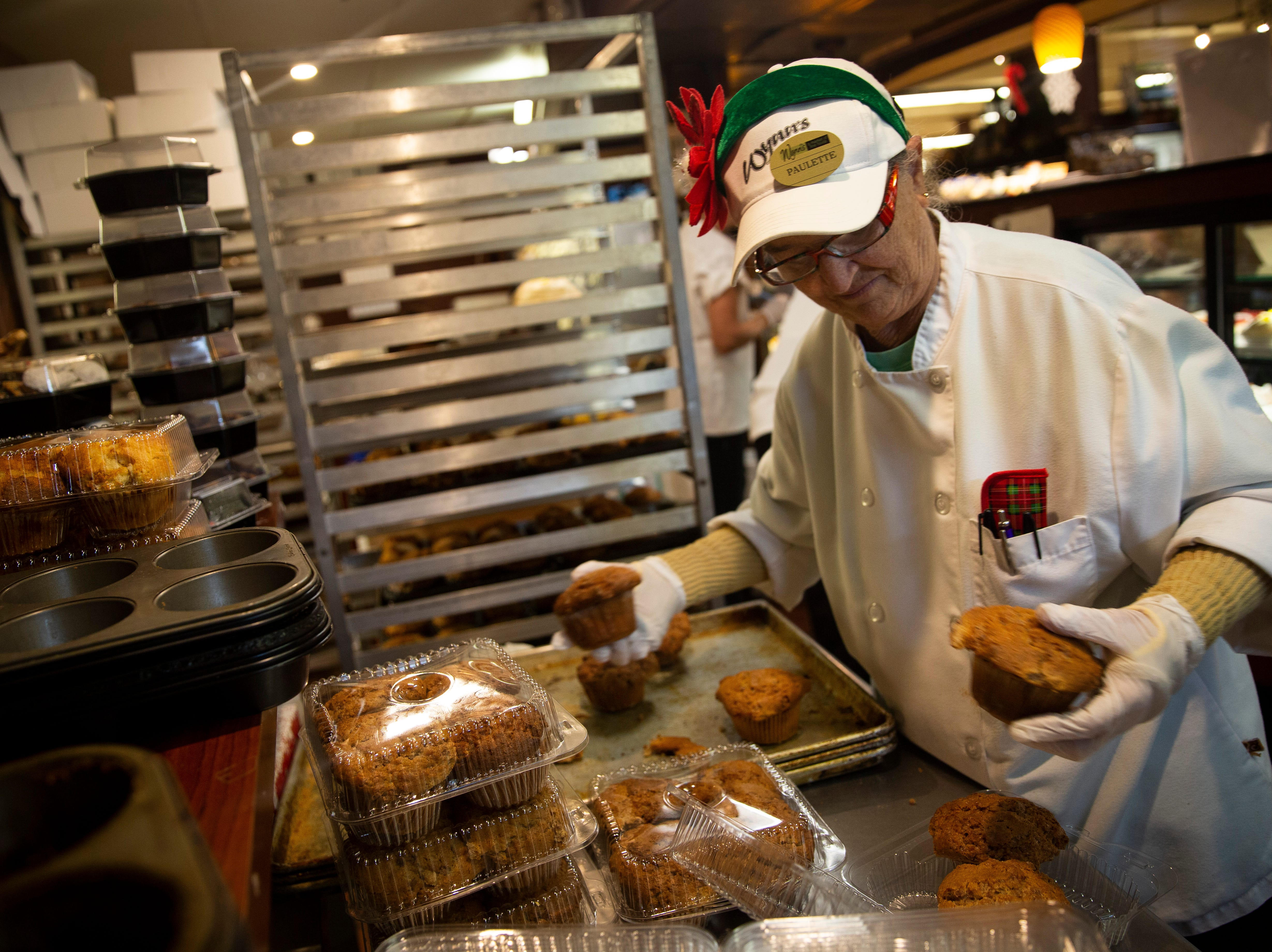 Paulette Dickerson packs cinnamon muffins into containers on Friday, Dec. 21, 2018, at Wynn's Market in Naples. Wynn's Market is celebrating 80 years in business this year.