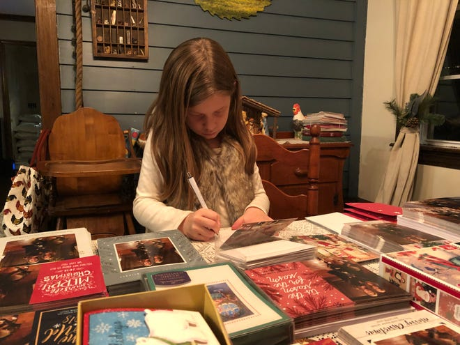 Adriana Pollock, a third grader at Newton Elementary, is preparing Christmas cards. Adriana is sending about 2,000 Christmas cards to those in nursing homes and foster care.