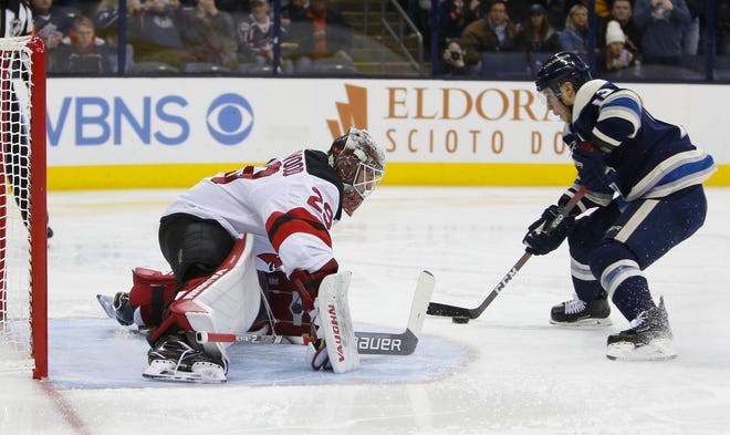 Columbus Blue Jackets' Cam Atkinson, right, scores on a penalty shot against New Jersey Devils' Mackenzie Blackwood during the second period of an NHL hockey game Thursday, Dec. 20, 2018, in Columbus, Ohio.
