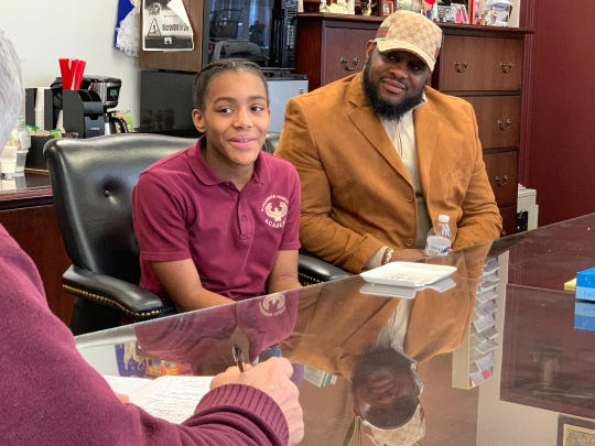 Imani Reaves, with her father, Edward Reaves, talking about her perfect PARCC scores