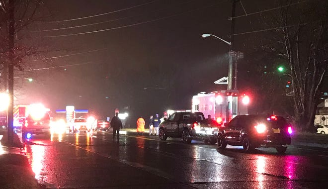 Police investigate after a pedestrian was struck by two cars and killed in Elmwood Park Dec. 20, 2018.