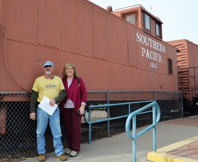 From left, Madison and Alayna Gross from North Cove, North Carolina, stopped at the Deming Visitor's Center on Friday to take in the iconic train that greets visitors behind the Deming-Luna Chamber of Commerce. at 800 E. Pine St. Madison said he enjoyed the Florida Mountains for its dragon-like peaks. The couple said they were visiting Deming to see their daughter who is a teacher at the My Little School preschool.