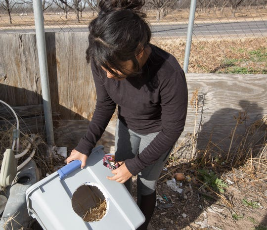 Norma Cervantes shows one of the feral cat house she has around her property off of Highway 28 on Friday Dec. 21, 2018.