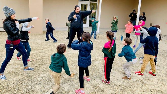Blue Dragon Dojo instructing Martial Arts to students at J Paul Taylor Academy.