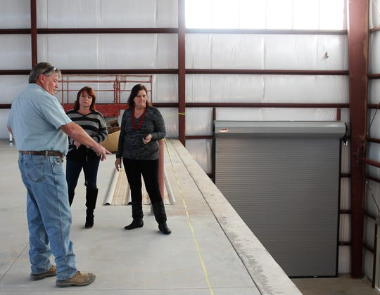 Otero County Solid Waste Superintendent Ralph Murphy, left, describes to Otero County Manager Pamela Heltner, center, and Otero County Commissioner Susan Flores, left,  how the main transfer building will accept trucks and trailers when the building is operational next spring.