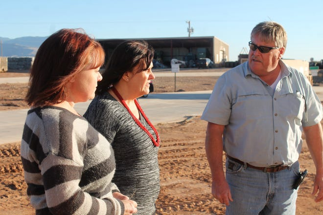Otero County Solid Waste Superintendent Ralph Murphy, right, explains what else needs to be done complete the La Luz Convenience Center to Otero County Commissioner Susan Flores, center, and Otero County Manager Pamela Heltner at the facility's soft opening Thursday.
