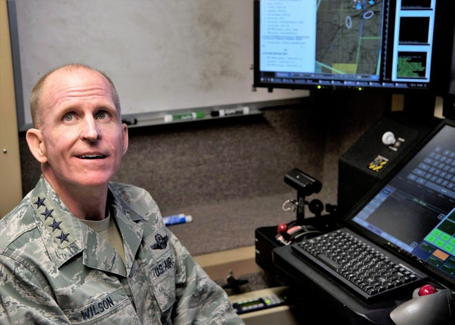 Air Force Vice Chief of Staff Gen. Stephen Wilson receives a briefing in an MQ-9 Reaper cockpit on Holloman Air Force Base, N.M., November 30. Wilson received a tour of Holloman, home to the Air Force's only MQ-9 pilot and sensor operator Formal Training Unit.