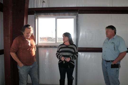 Joe Lewandowski of Operation Consultants, left, tells Otero County Manager Pamela Heltner and Otero County Solid Waste Superintendent Ralph Murphy about the strategically placed windows in what will be Murphy's office when the main transfer station building is completed next spring.