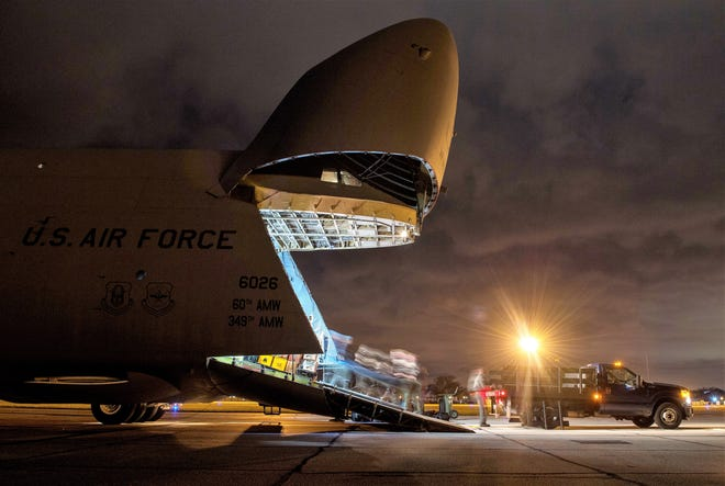 U.S. Airmen with the 22nd Airlift Squadron and 60th Aircraft Maintenance Squadron from Travis Air Force Base, California along with Air Mobility Command Airmen onload aeromedical evacuation equipment onto a C-5M aircraft at Scott Air Force Base, Illinois during an AE proof of concept evaluation, Dec. 2, 2018. Active Duty, Reserve and Delaware Air National Guard Airmen worked together during the PoC to test the cargo compartment of the C-5M with the goal of establishing the aircraft as part of the universal qualification training program for all AE crews. If approved and certified, the C-5M will have the capability to move three times the current capacity in one mission compared to other AE platforms.