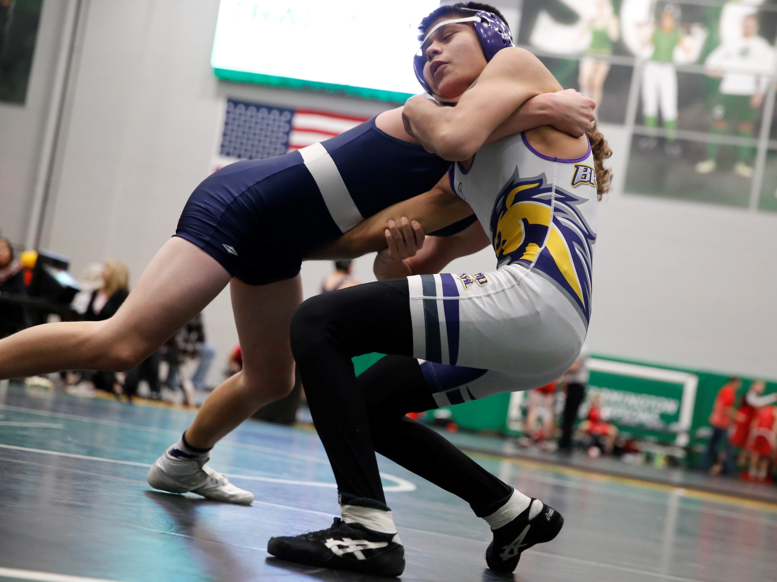 Kirtland Central's Dominique Benally withstands Piedra Vista's Trey Brock during a 138-pound division match at Thursday's Farmington Scorpion Duals. Benally won at the 1:52 mark in the first round.