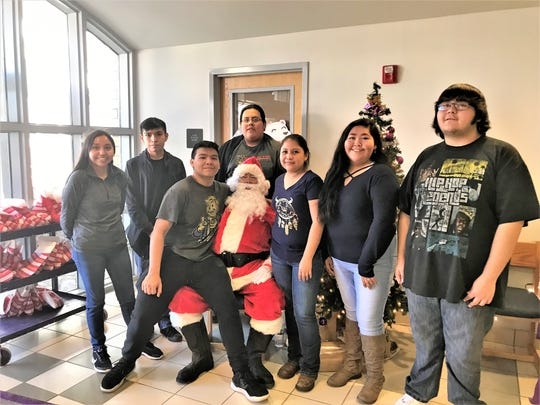 A few more student council elves shared their wishes with Santa Claus. From left are Shyla Klinekole, Pierre Sago, Michael Bruselas, Xavier Hubbard, Terryne Chee, Hailee Bigmouth and Nakai Begay.