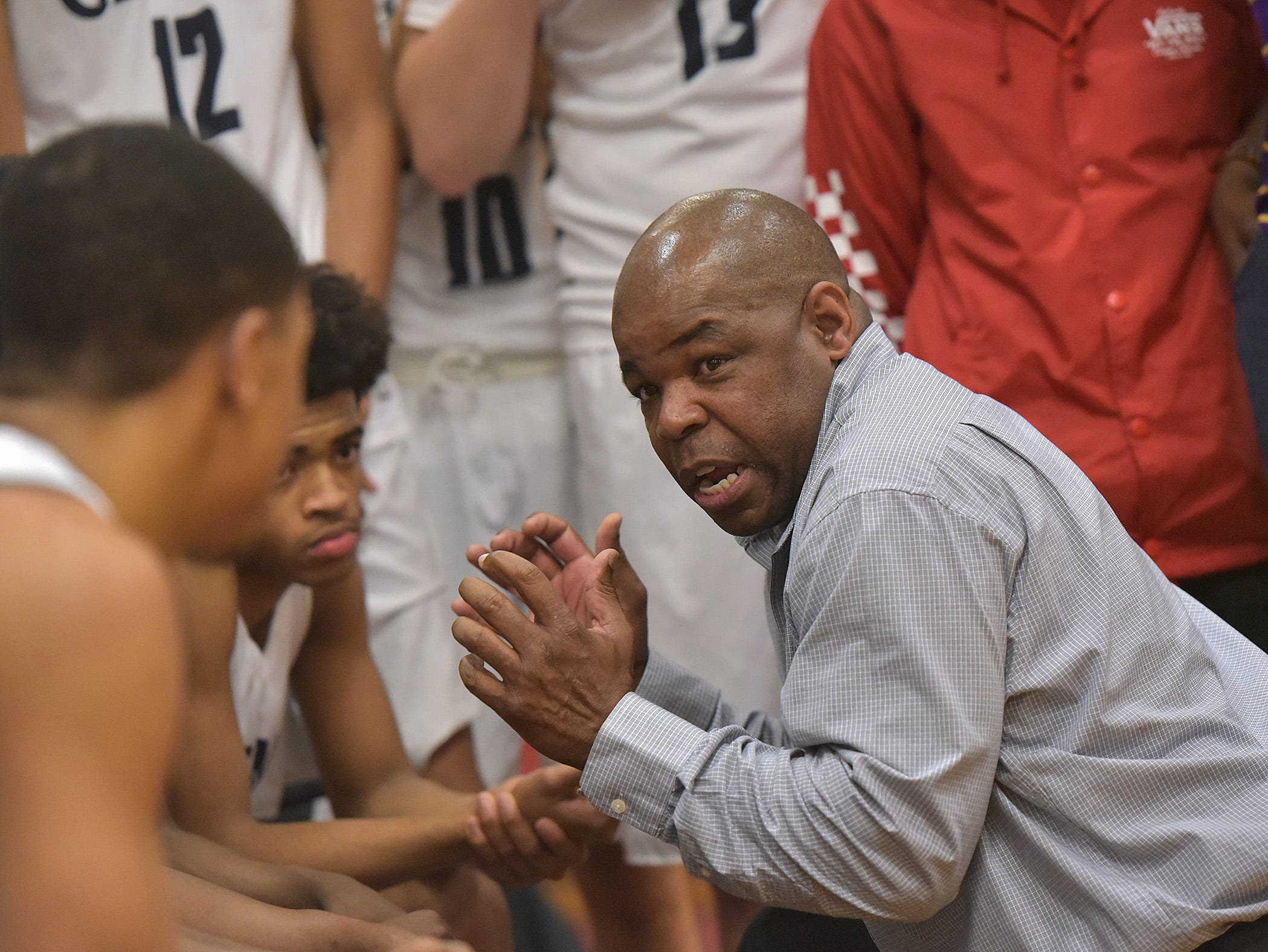 Glenn head coach Rod Watts speaks to the team in the fourth quarter of the game,