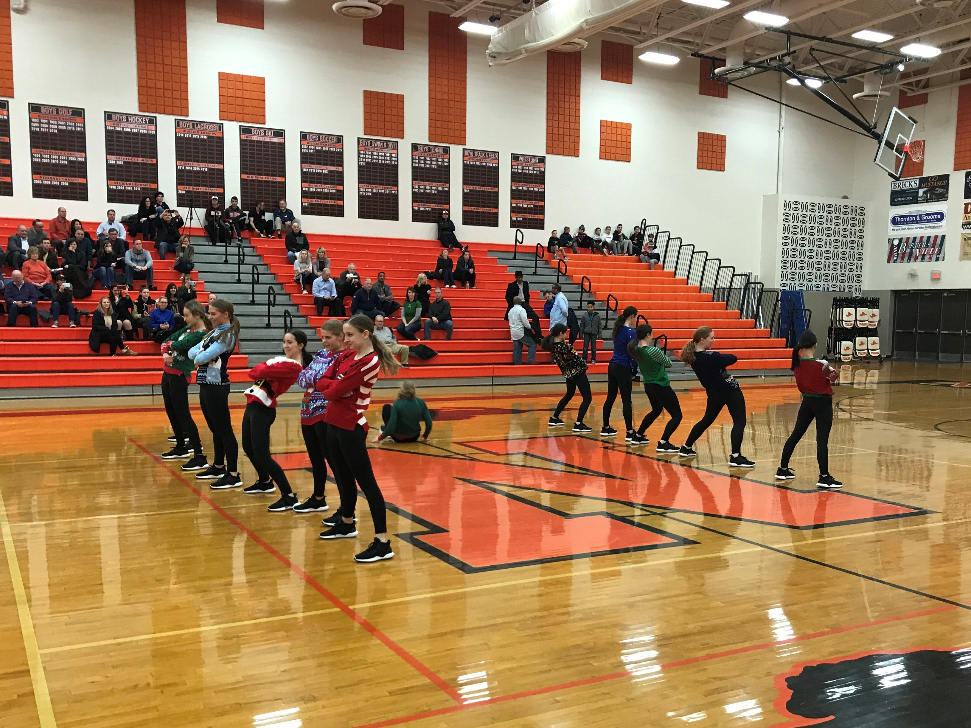 Halftime featured Northville cheerleaders displaying their 'ugly Christmas sweaters' as part of their routine.
