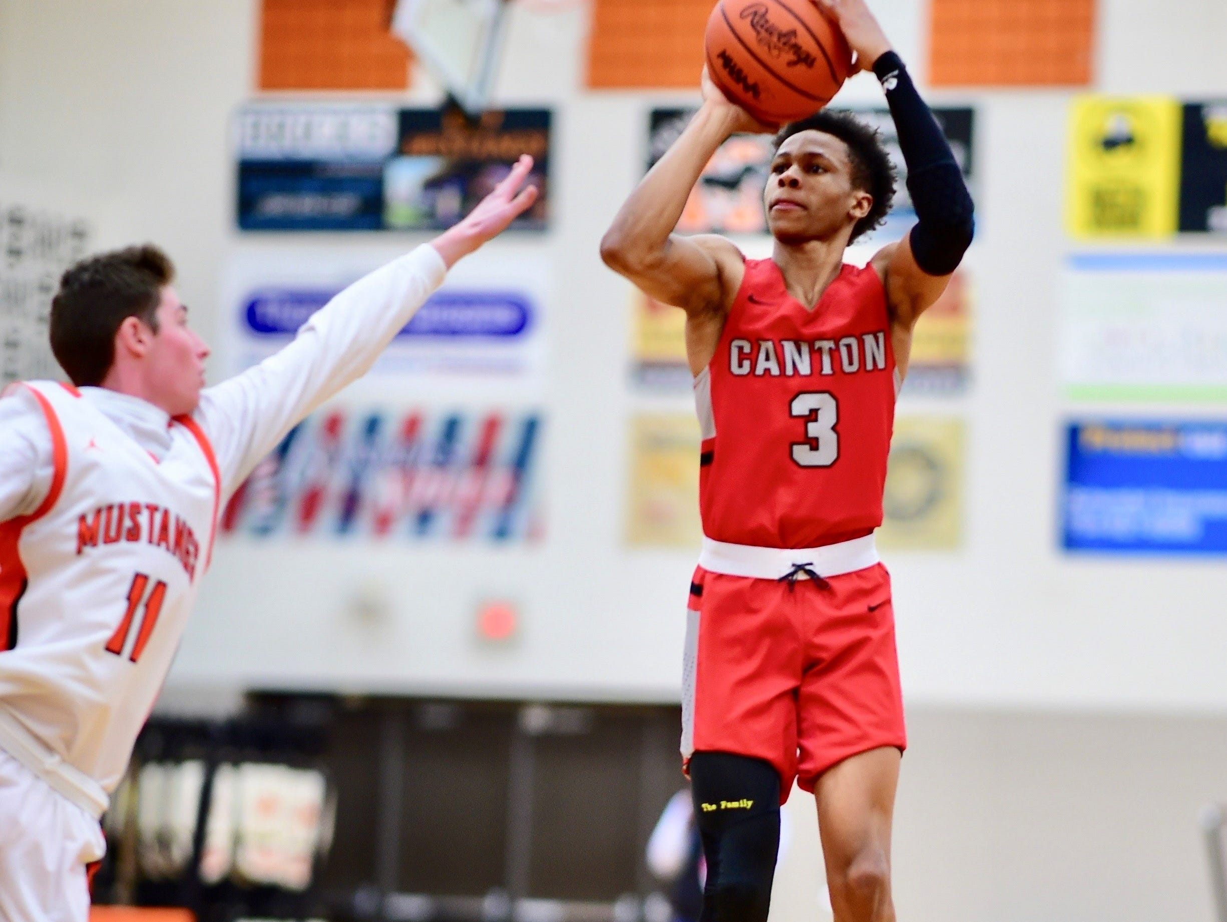 This was a regular sight Thursday: Canton guard B. Artis White launching a long jumper. He drained five treys in the Chiefs' 65-46 win over Northville. Shown for Northville is Tyler Milo (11).