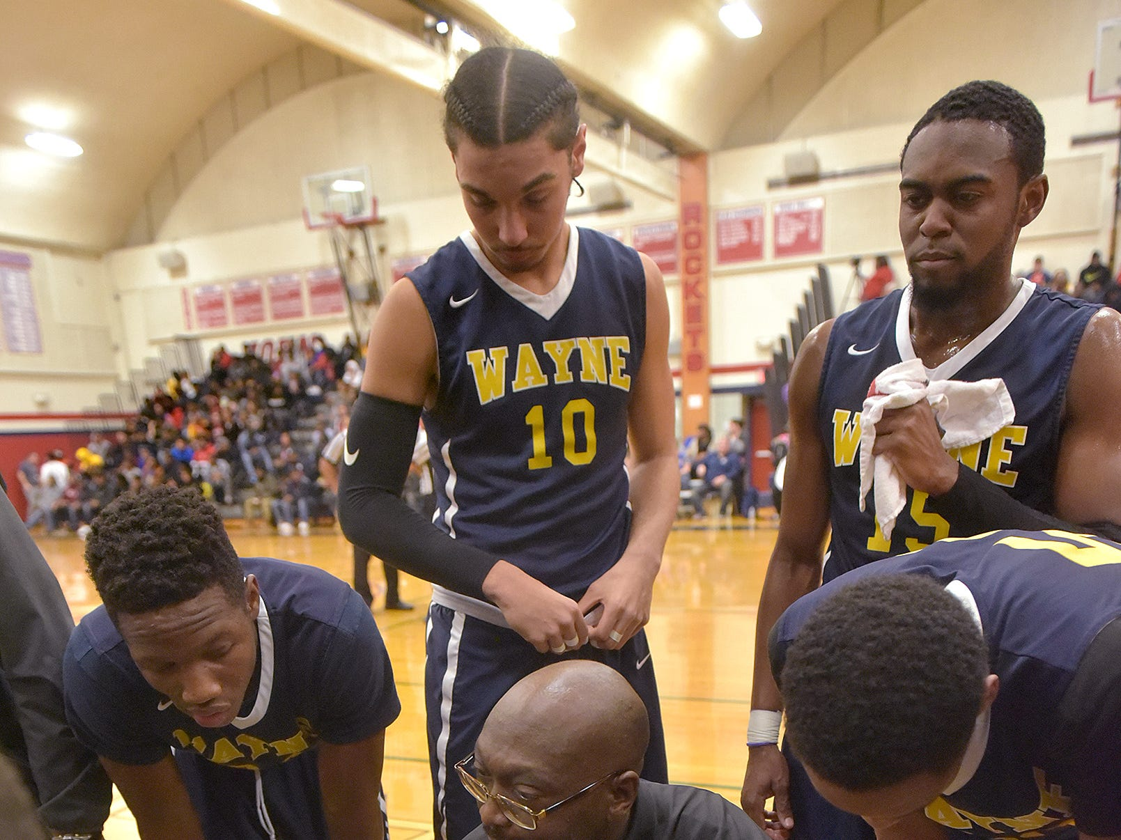 Wayne coach Nkwane Young speaks with the team during a time out.