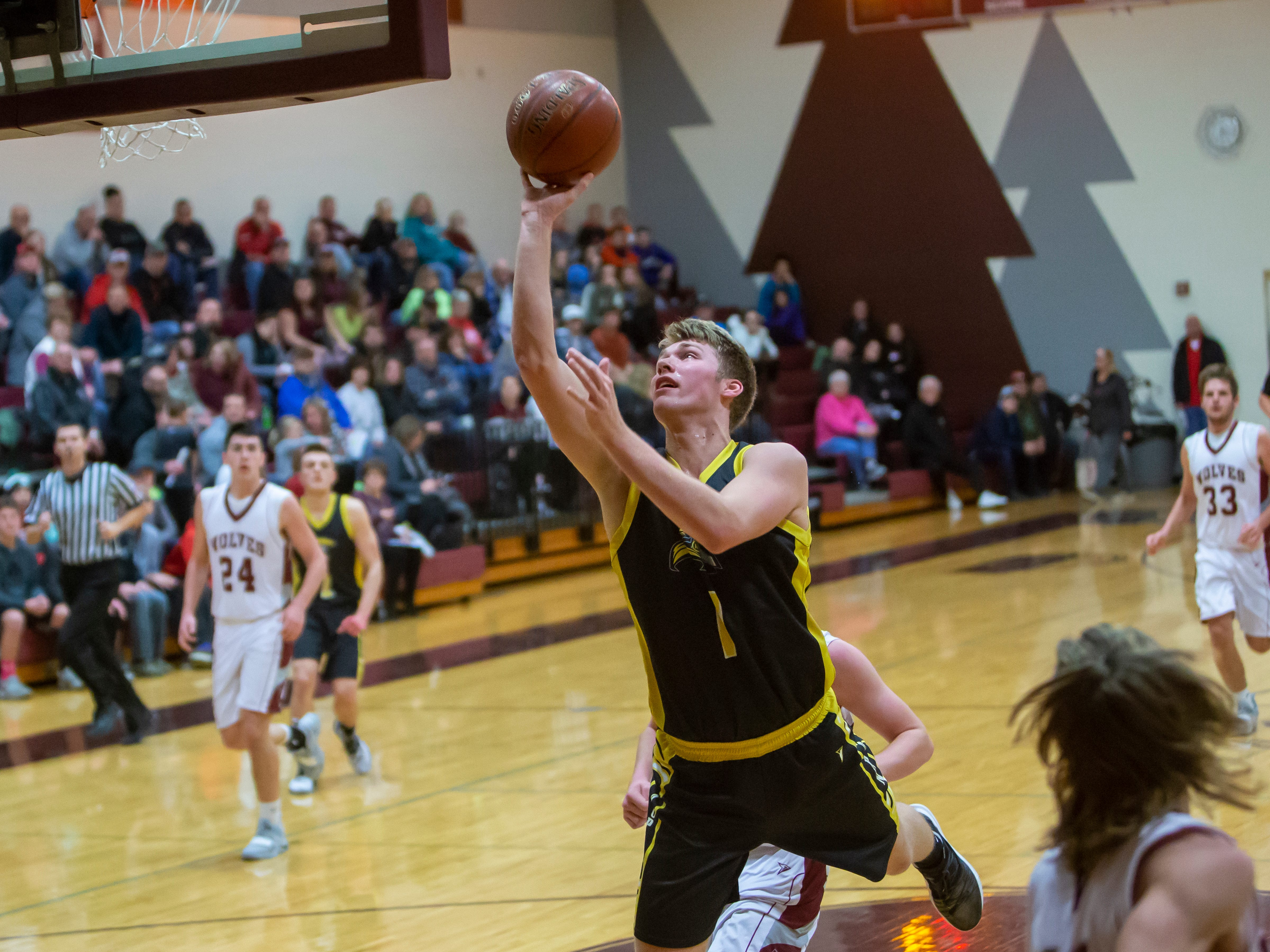 Waupun's Marcus Domask lays up a shot playing at Winneconne High School on Thursday, Dec. 20, 2018.