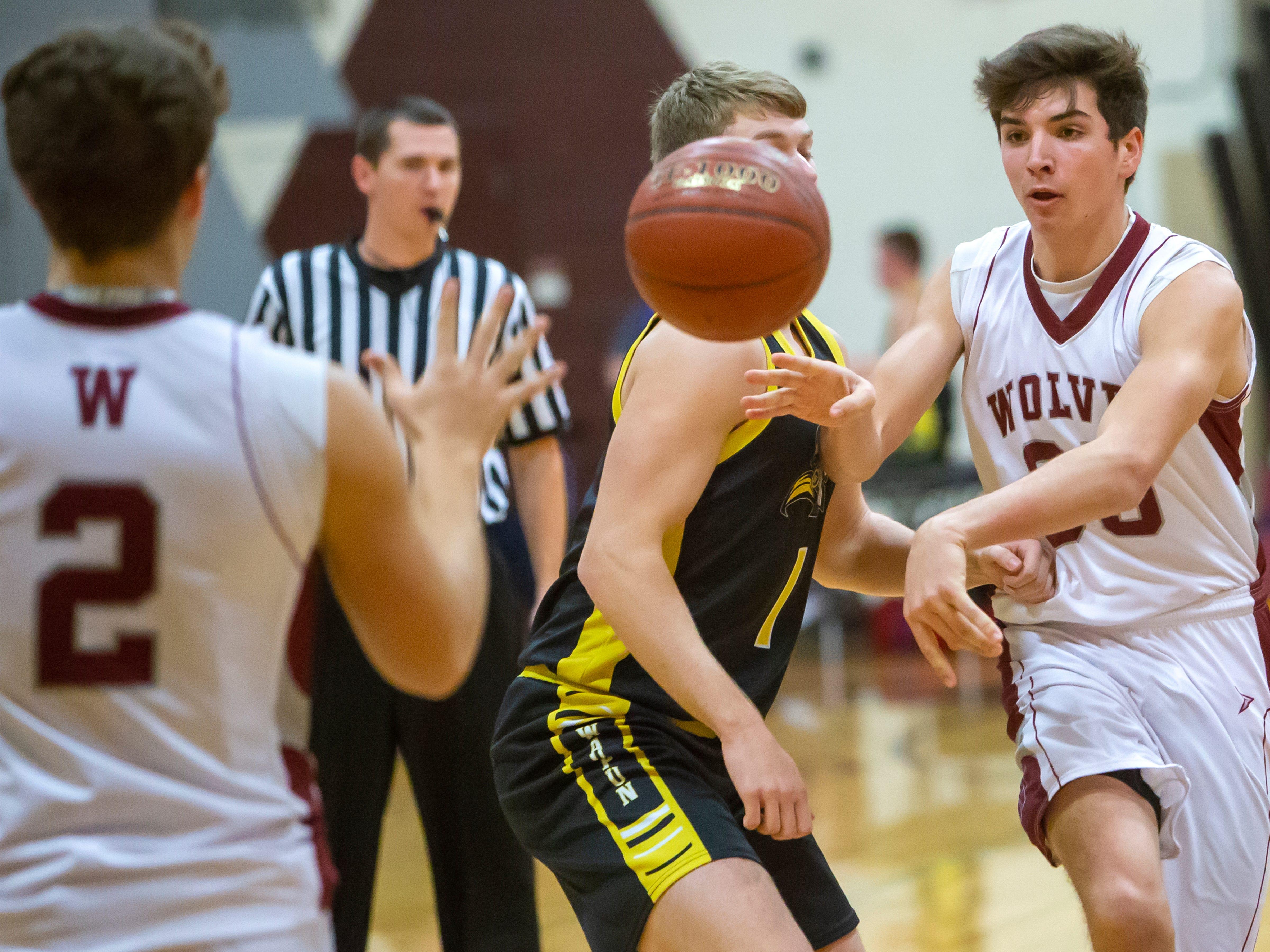 Winneconne's Greg Murawski throws a pass to Austin Hecker at Winneconne High School on Thursday, Dec. 20, 2018.