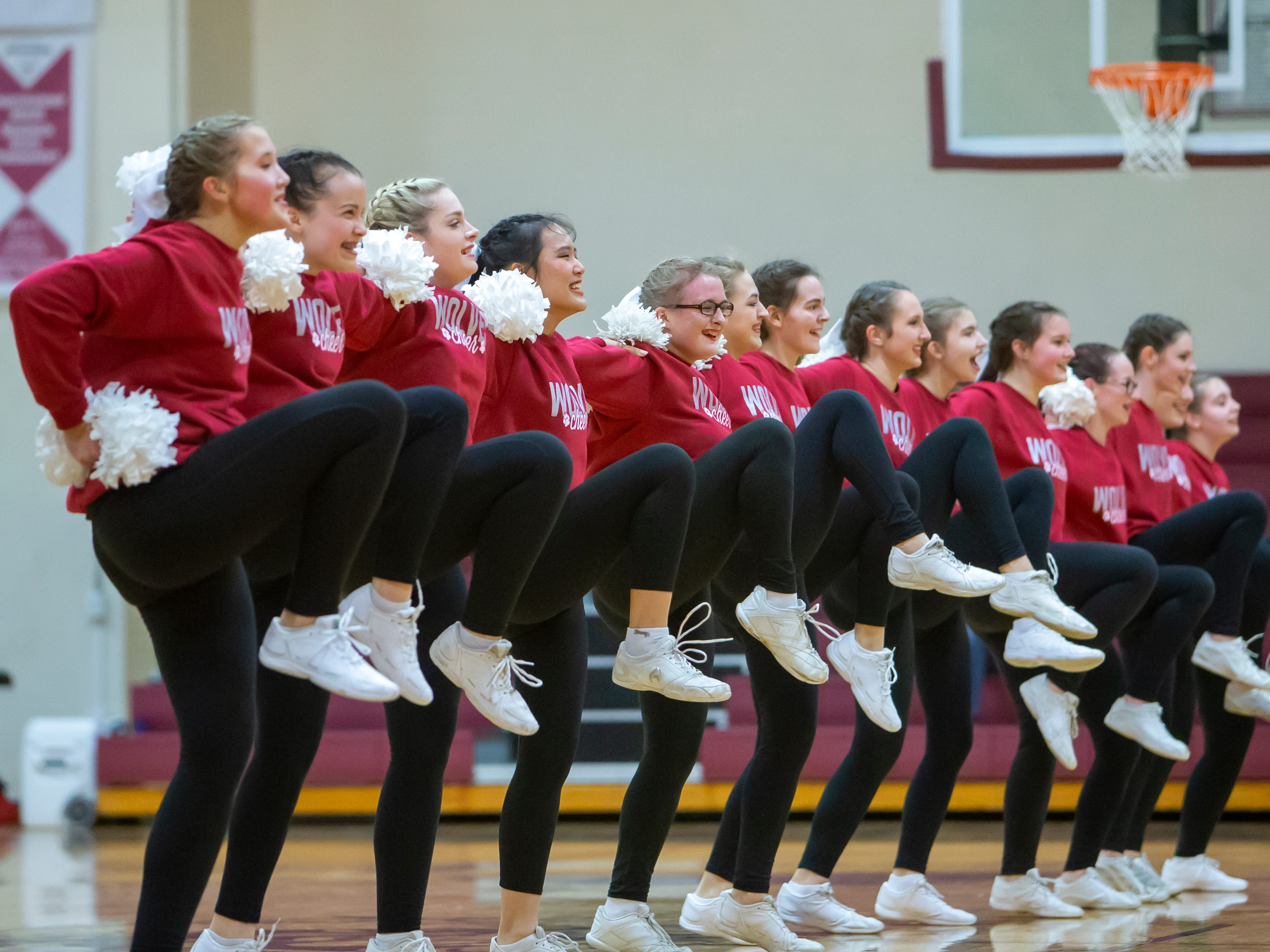 The Winneconne dance team performs for the basketball game half-time entertainment at Winneconne High School on Thursday, Dec. 20, 2018.