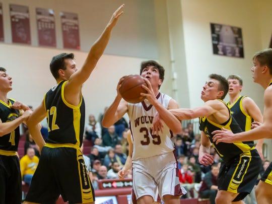 Winneconne's Greg Murawski drives to the basket against Waupun on Thursday at Winneconne High School.
