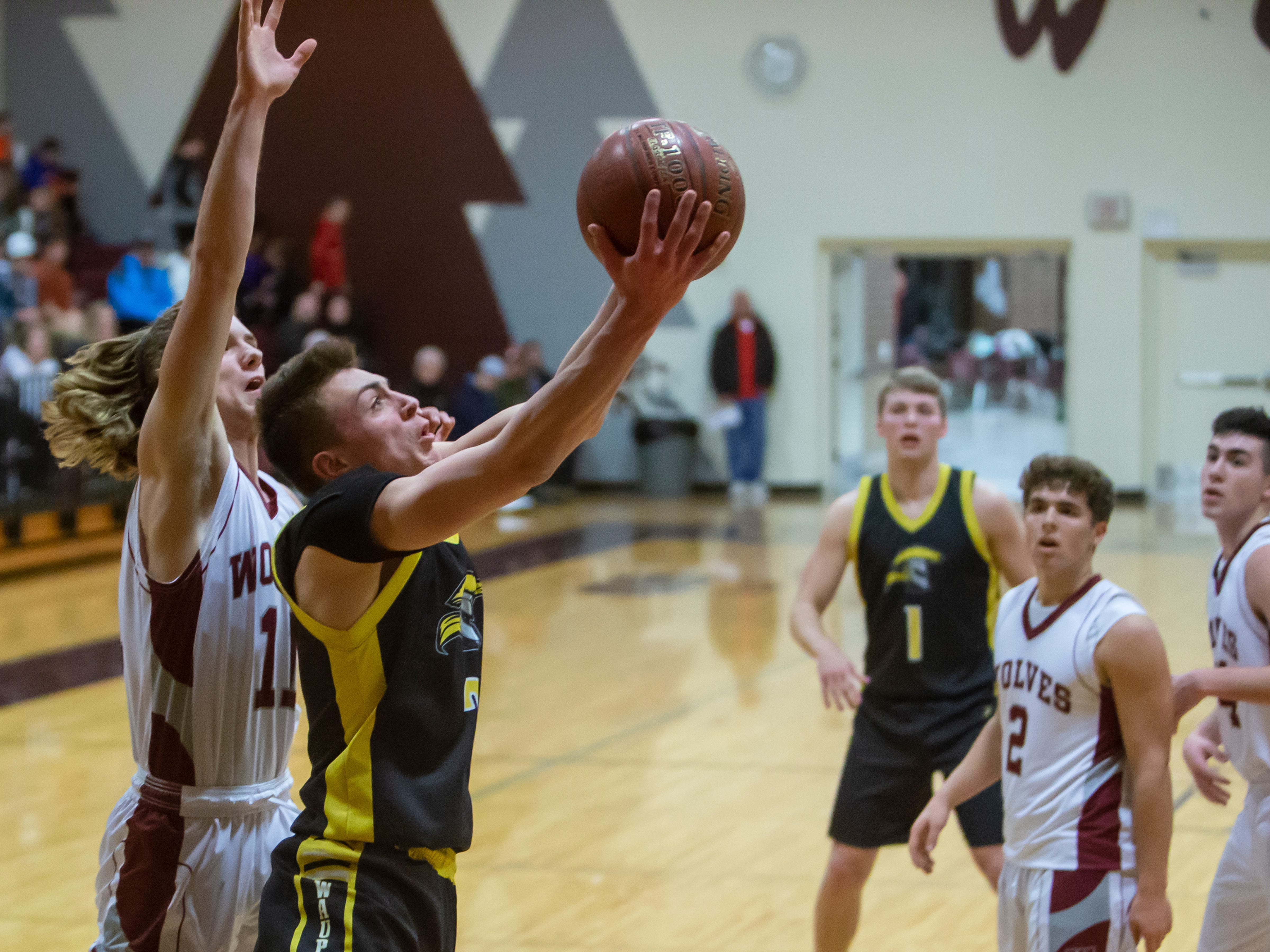 Waupun's Trevor VandeZande goes up for a shot playing at Winneconne High School on Thursday, Dec. 20, 2018.