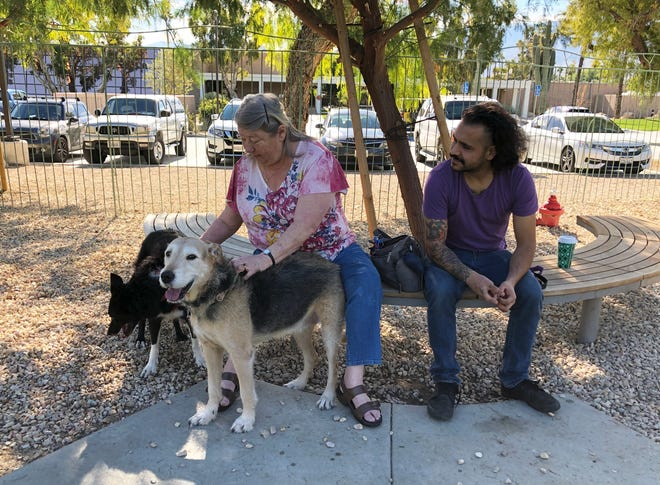 Linda Steen, left, and Erik Steen at the dog park at Palm Springs City Hall.
