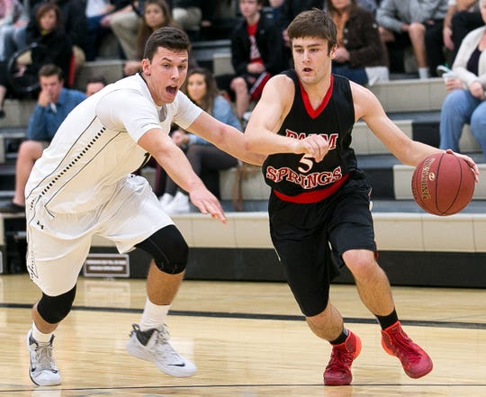 Jake Ashton, left, during basketball action between Xavier Prep and Palm Springs in Jan. 2014.
