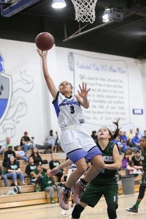 Nina Wallace soars to the hoop against Twentynine Palms on Thursday.