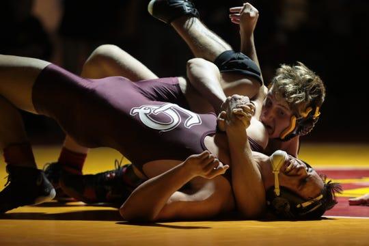 Palm Desert's Caleb VanBuskirk wrestles Aidan Miller of La Quinta, December 20, 2018.