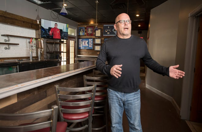 Owner Ed Riley talks Friday about his new Alcaniz Kitchen & Tap in downtown Pensacola.